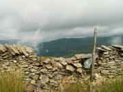 Old stone wall falling down