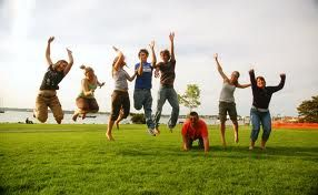 Group of people in park jumping with joy