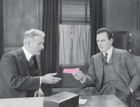 Image: Boss handing out pink slip