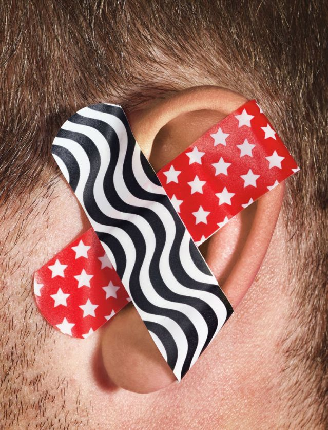 Image: Two bandaids crossed on an ear