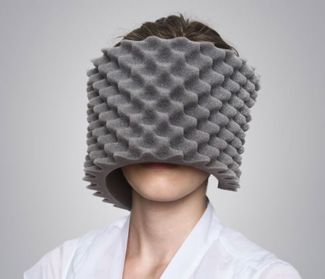Image: woman with egg crate foam covering her face