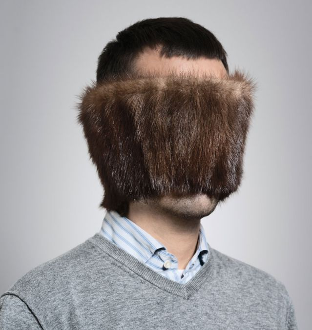Image: Man with fur covering his face
