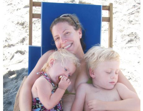 Image: Nicole Kear on the beach with her children